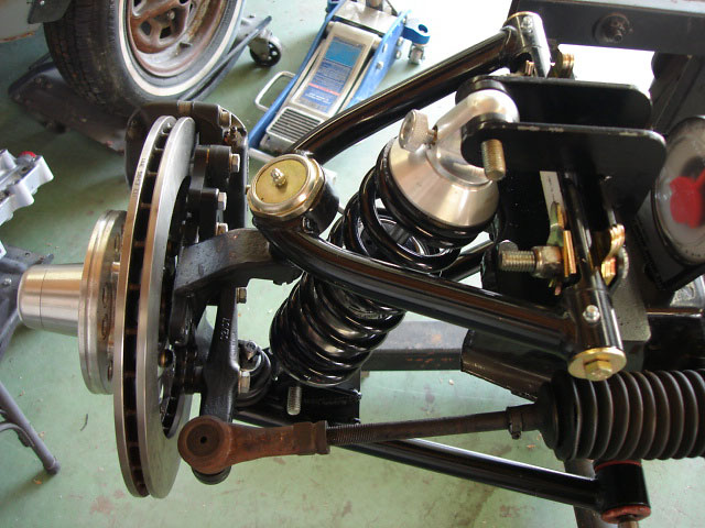 Front Coil Over Suspension w/ camber adjustment and adjustable shocks